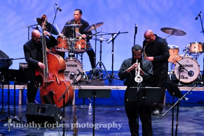 Nasar Abadey, drums, John Williams, trumpet, Joe Ford saxophone, and James King, bass