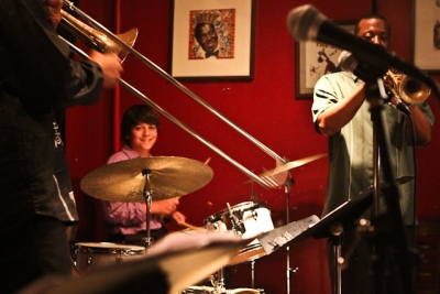 Alex Panagos, drums, Kenny Rittenhouse, trumpet, and Reginald Cyntje, trombone