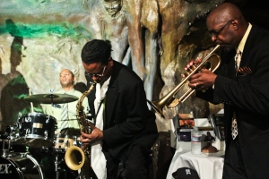 Michael Thomas, trumpet, Zach Graddy, saxophone, and Frank Williams, drums