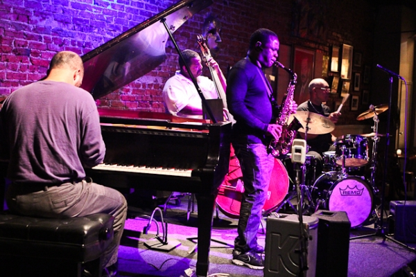Antonio Parker, saxophone, Keith Killgo, drums, and Darius Scott, piano
